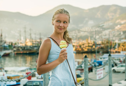 Young woman with turkish ice cream at sunset  Alanya  Turkey