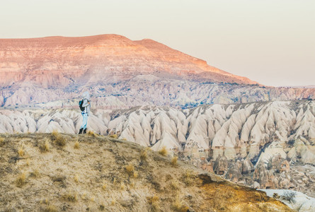 Young woman traveller hiking in mountains in Cappadocia  Turkey