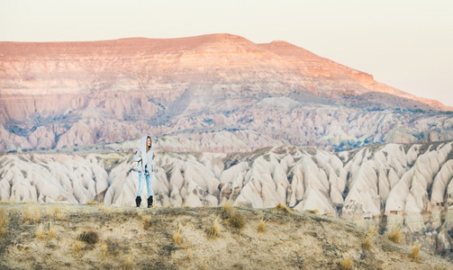 Young woman traveller hiking in mountains in Cappadocia  Central Turkey