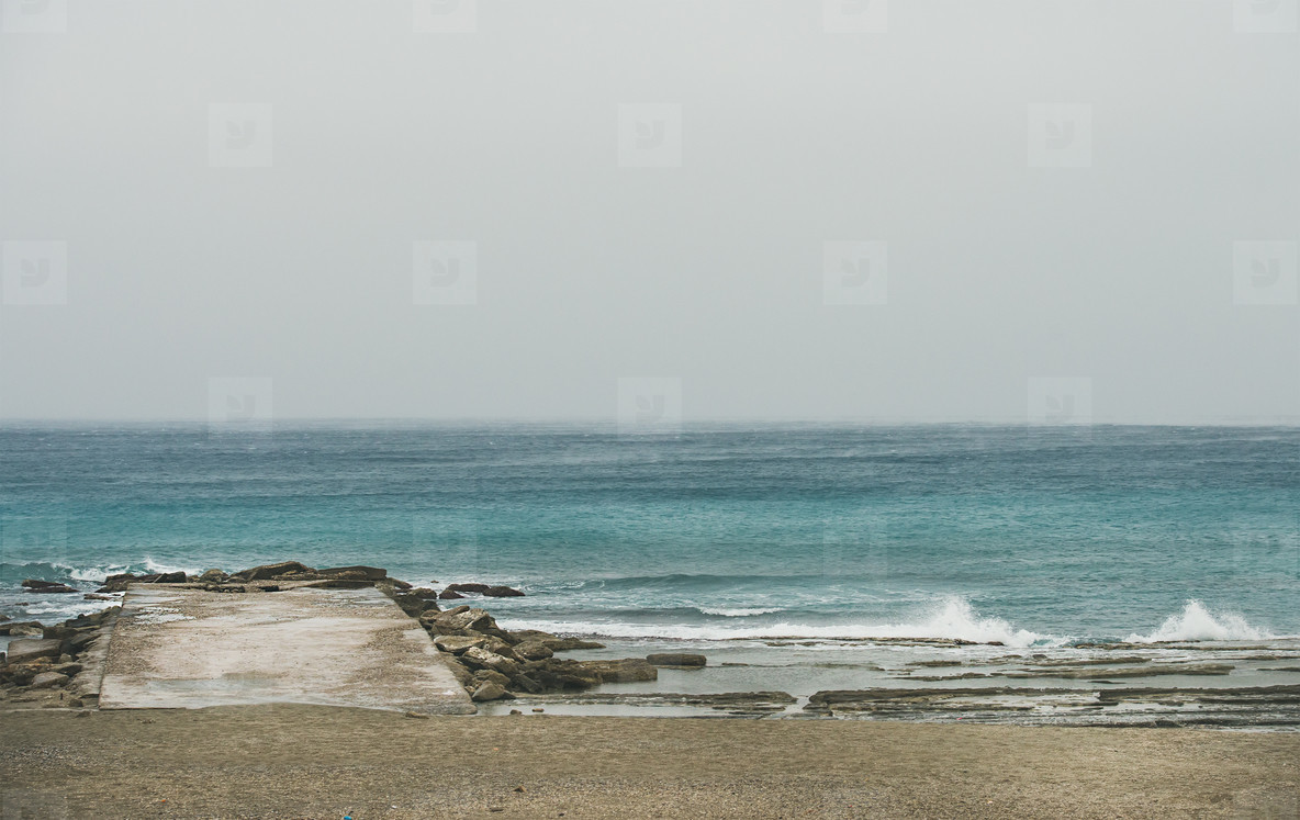 Empty sandy coast and pier after storm  Alanya  Turkey