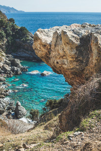 Rock over chasm and beautiful natural lagoon down  Turkey
