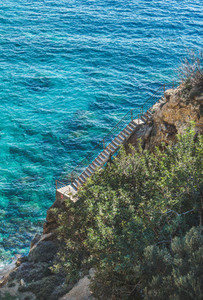 Stairs leading down to lagoon and turquoise sea waters Turkey
