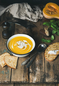 Pumpkin cream soup with fresh basil  spices and grilled bread