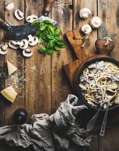 Creamy mushroom pasta spaghetti in cast iron pan copy space