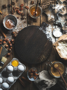 Christmas holiday cooking and baking ingredients with board in center