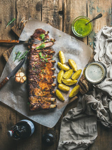 Roasted pork ribs with spices fried potato and dark beer