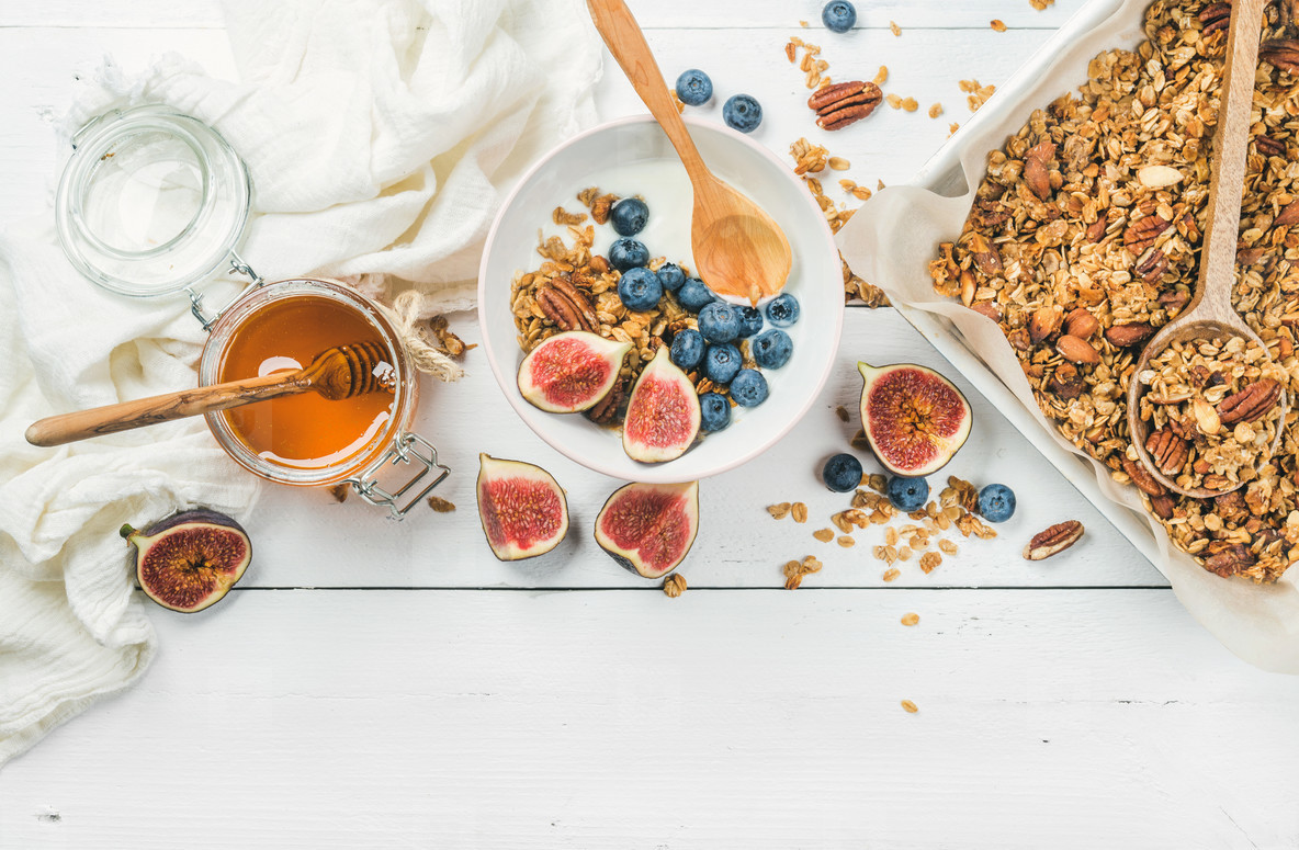 Oat granola with nuts  yogurt  honey  fresh figs and blueberries