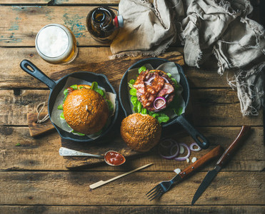 Homemade beef burgers with crispy bacon and wheat beer