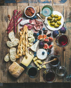 Wine and snack set with wines meat bread olives berries