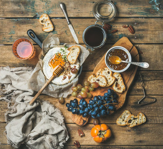 Cheese  fruit and wine set over rustic wooden background