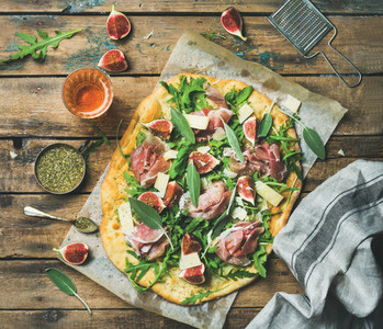 Fig  prosciutto  arugula and sage flatbread pizza with rose wine