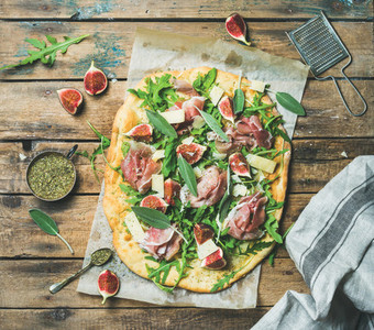 Fig prosciutto arugula sage flatbread pizza with spices in mug