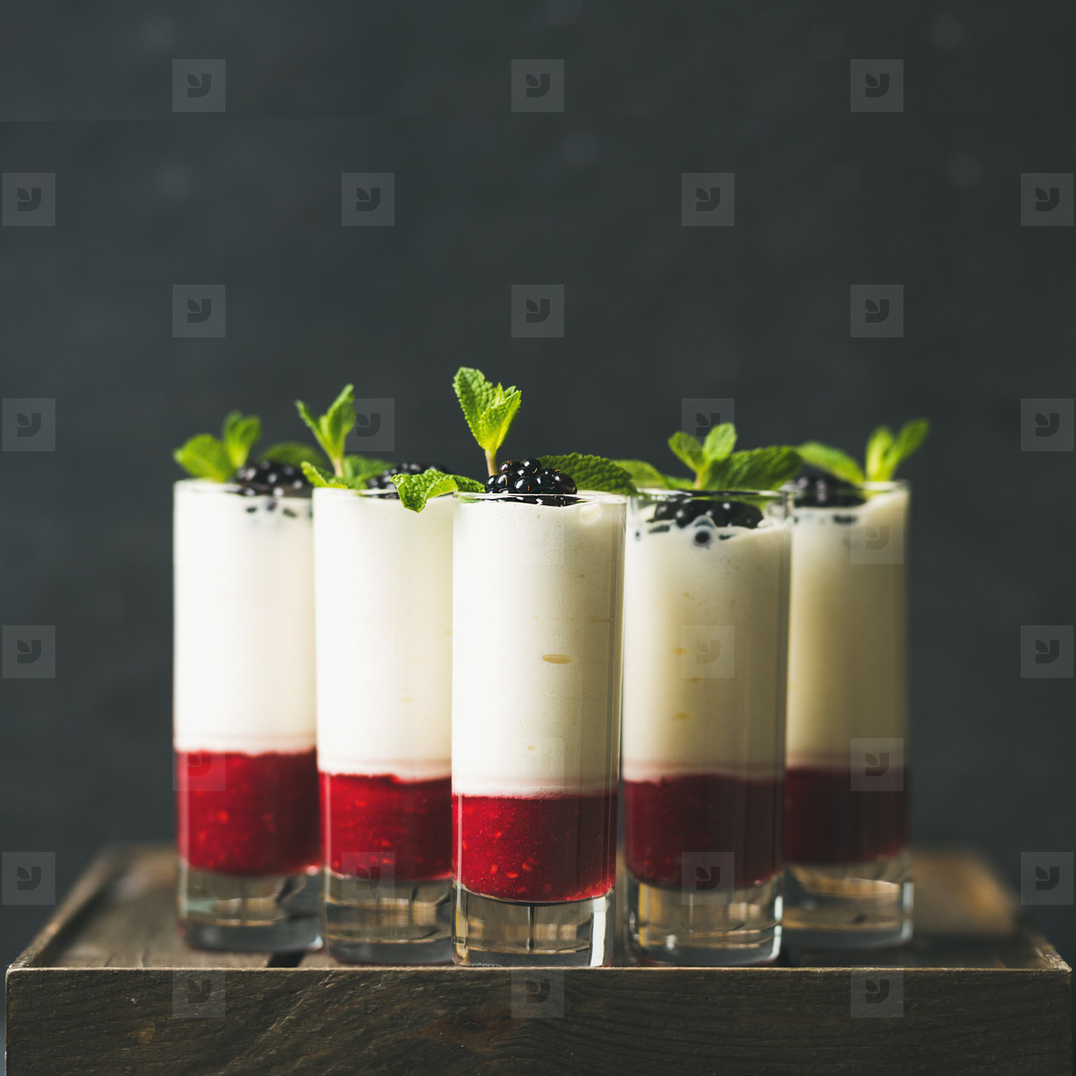 Dessert in glass with blackberries and mint  square crop