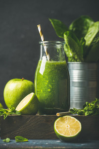 Green smoothie in bottle with apple  romaine lettuce  lime  mint