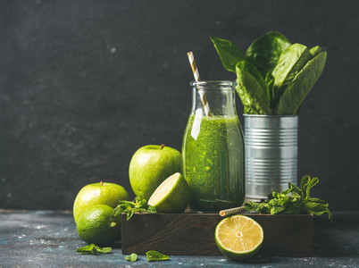 Green smoothie in bottle with fresh fruits  copy space