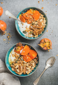 Healthy vegetarian breakfast with seeds  oatmeal  fresh and dried fruit