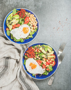 Healthy breakfast concept with fried egg chickpea sprouts seeds greens