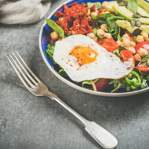 Dieting concept breakfast with fried egg  chickpea  vegetables  seeds