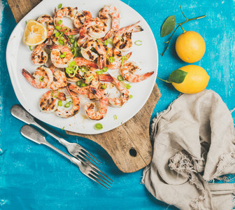 Grilled tiger prawns in white plate with lemon  leek  chili