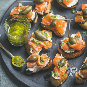 Close up of salmon crostini with homemade pesto sauce