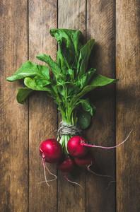 Fresh radish bunch over wooden background