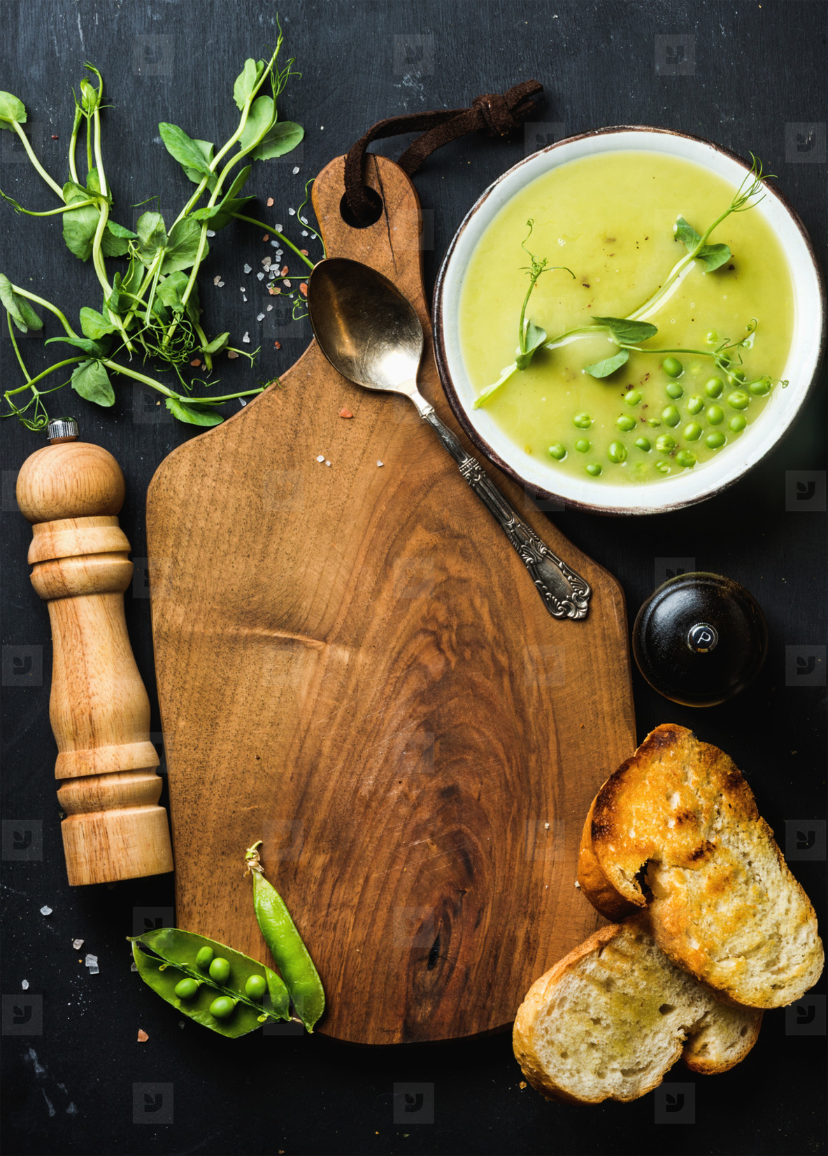 Fresh homemade pea cream soup with bread  copy space