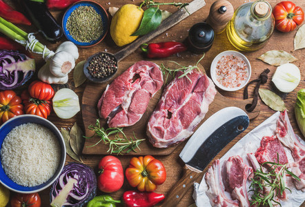 Raw uncooked lamb meat assortment rice olive oil vegetables spices