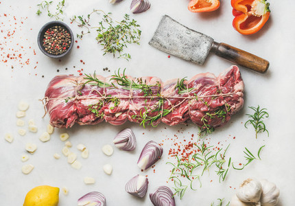 Raw uncooked roast beef meat with herbs  vegetables  spices