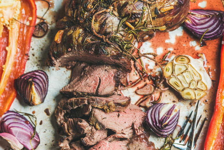 Cooked Roastbeef meat with grilled vegetables and herbs  top view