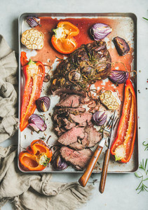 Cooked Roastbeef meat with grilled vegetables and herbs