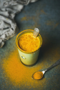 Golden milk with turmeric powder  clean eating detox concept