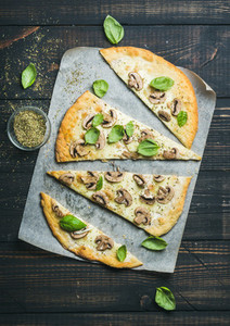 Homemade mushroom pizza with basil and spices in glass