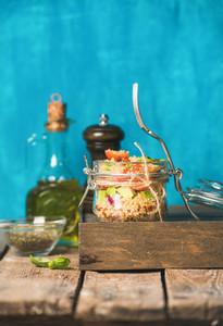 Healthy homemade quinoa salad with tomatoes avocado and fresh basil