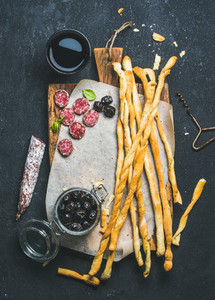 Grissini bread sticks  cured pork sausage  olives and red wine