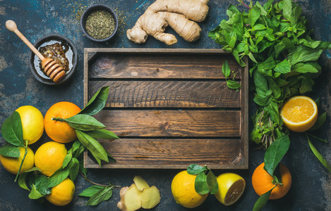 Fruits and herbs for making hot drink tray in center