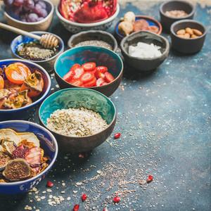 Ingredients for healthy breakfast over dark blue background  square crop