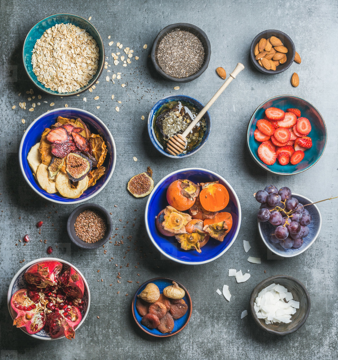 Ingredients for healthy breakfast over grey stone background