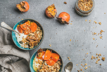 Healthy vegetarian breakfast in blue bowls  copy space