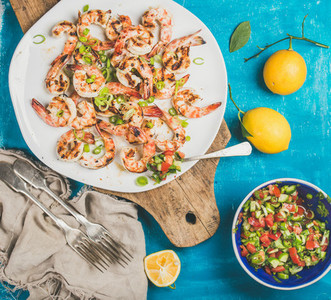 Grilled tiger prawns in white plate with lemon  salsa sauce
