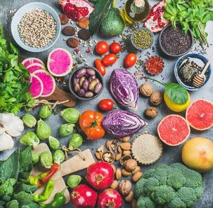 Healthy raw food variety over grey concrete background