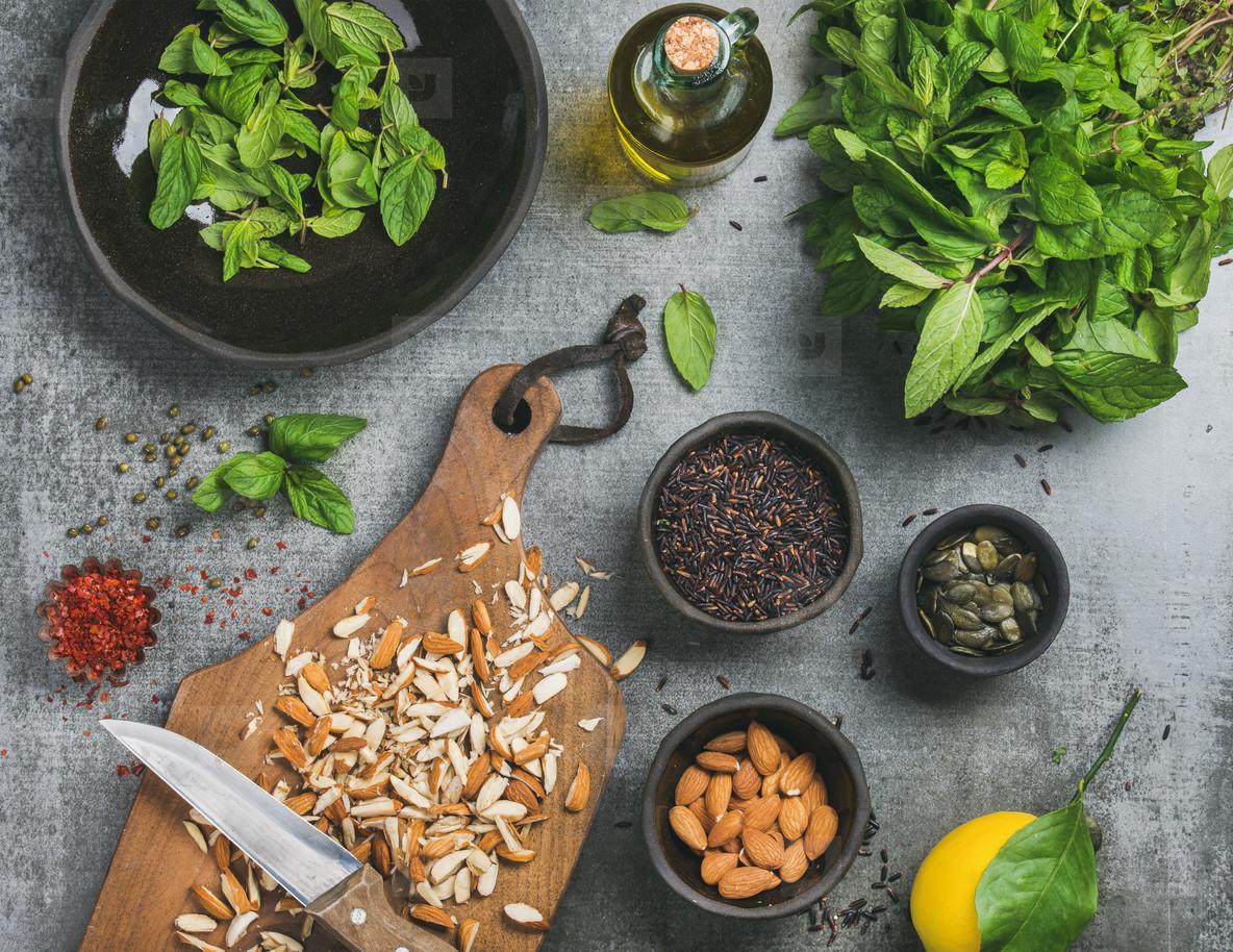 Healthy  vegan  clean eating cooking ingredients over grey background
