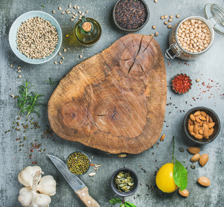 Ingredients for healthy cooking over grey concrete textured background