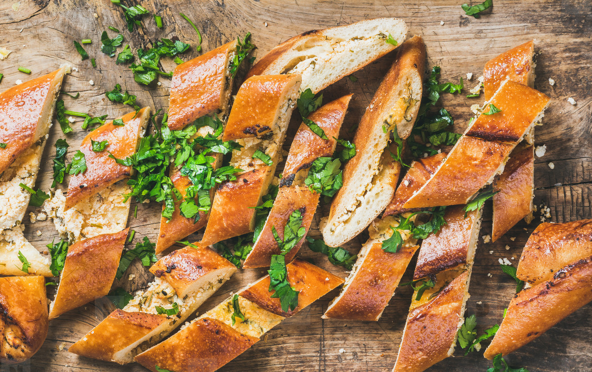 Close up of chopped Turkish pizza pide with cheese and spinach