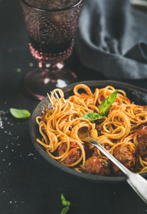 Spaghetti with meatballas  fresh basil leaves and red wine