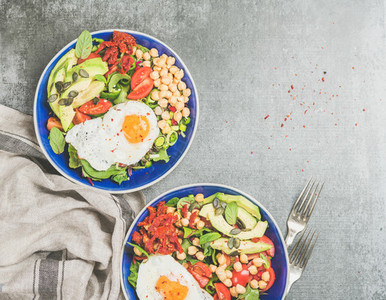Healthy breakfast with fried egg  chickpea sprouts  seeds in bowls