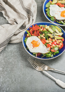 Healthy breakfast with fried egg chickpea vegetables seeds copy space