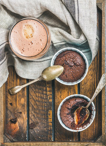 Chocolate souffle in baking cups and mocha coffee  copy space
