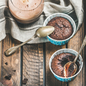 Close up of Chocolate souffle in baking cups and mocha coffee