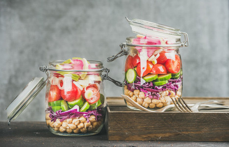 Healthy salad in jars with vegetables and chickpea sprouts