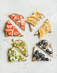 Healthy breakfast wholegrain toasts with cream cheese  fruit  seeds  nuts
